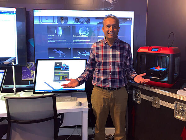Anjon Roy, SIMBA Chain VP of Market Development, at SIMBA's kiosk at the Microsoft Innovation & Policy Center